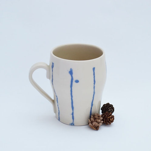 Cream mug with abstract blue lines