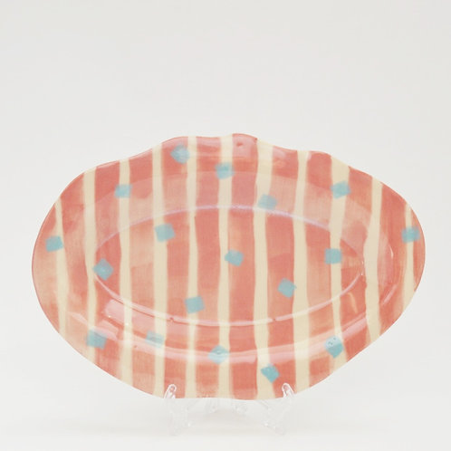 Pale orange stripped plate with blue squares