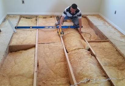Our  #1 installer Max trimming floor joist to eliminate high spots in subfloor before installing new wood floor