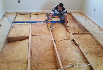 Our  #1 installer Max trimming floor joist to eliminate high spots in subfloor before installing new wood floor