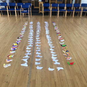 making doves out of used recylable paper