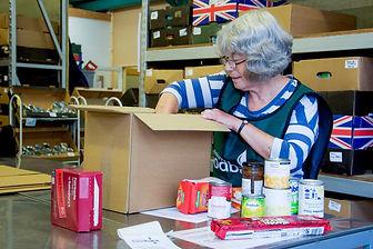 lady-volunteer-packing-foodbox-wide-1024