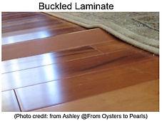 buckled laminate floor