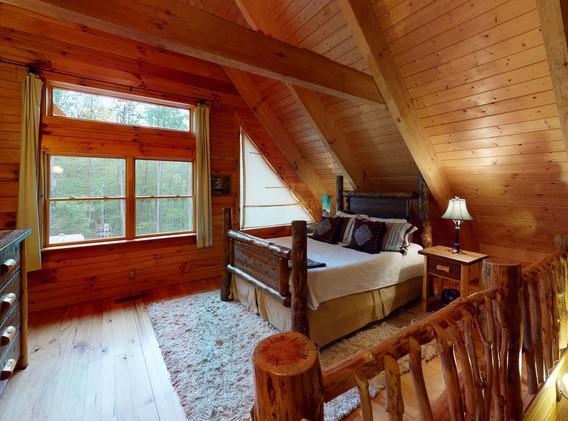 Queen bed in open loft