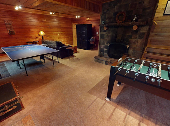 Lower level game room with fireplace