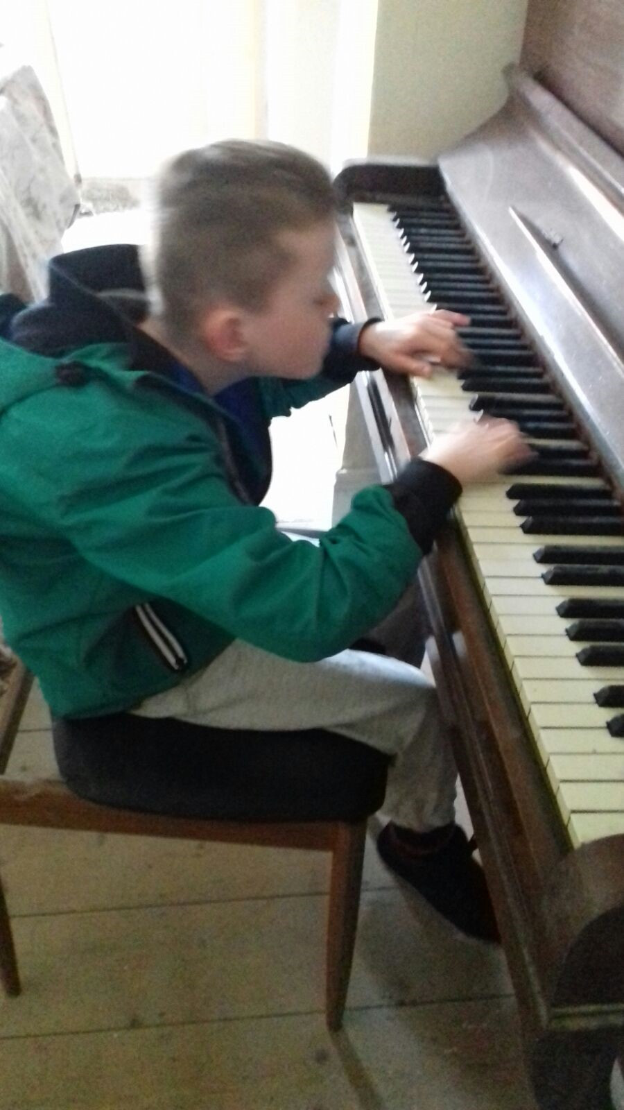 Tadhg playing the piano