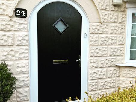 Composite door with arched head