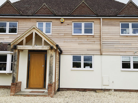 Double glazed PVC flush casement windows in heritage white woodgrain finish