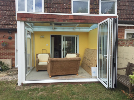Lean-to conservatory with bi-fold doors