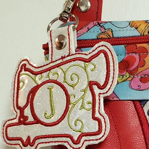 Initialed Sewing Machine Snap Tab