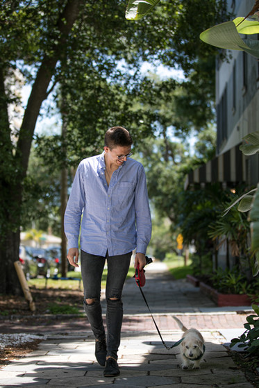 """""""My walks in the Old Northeast with my dog, Kino, offer those sparing moments of levity in an otherwise heavy time. Kino is also the thing that grounds me when I jump down the rabbit hole of news. I proudly work on the I Love the Burg and That's So Tampa blogs during the day, and I find myself consistently in awe of the resiliency and resolve of this community. So, the smile on my face is in part from this wonderful, wild carrot-devouring 10-year-old dog, and because I love the city I live in so much. It's a fact I'm reminded of every time I look out my window."""" - Andrew Harland of I Love The Burg - Photo by Sandrasonik"""