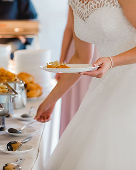AdobeStock_212513113 bride serving food.