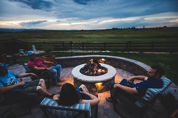 People+enjoying+a+gas+fire-pit+and+paver