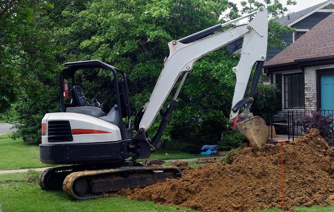 excavator_at_residential_home.jpeg