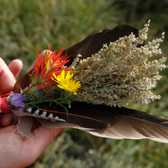 offering bundle safe flowers and feathers