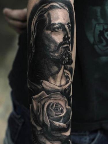 Andrew Lions Den Jesus tattoo .jpg