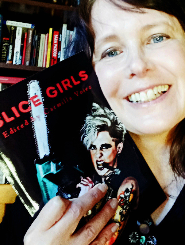 Carmilla Voiez holding paperback copy of Slice Girls
