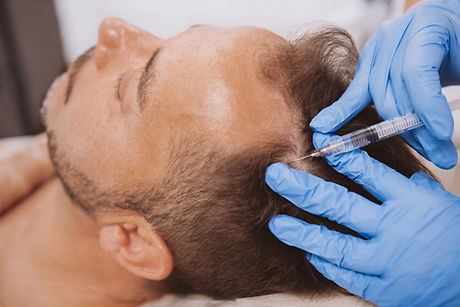 Close up of a mature man receiving hairl