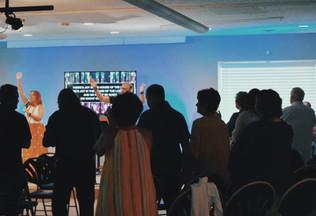 Carl Leading Worship with Crowd.JPG