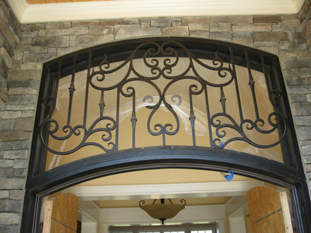 Custom iron doors by local Charlotte Blacksmith