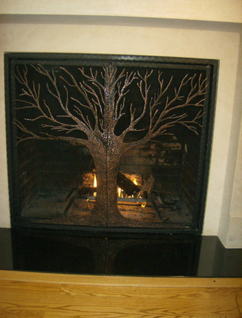 Custom iron fireplace screens by local Charlotte Blacksmith