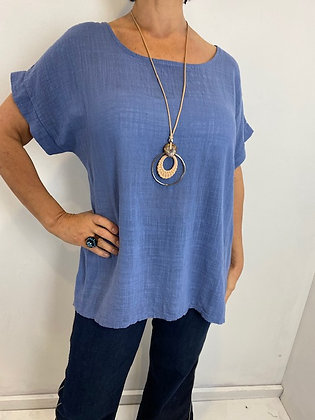 Cornflour blue top with necklace