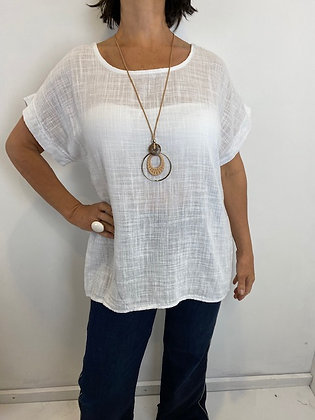 White top with necklace