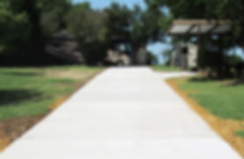 16_Completed_Cured_Driveway_Entrance_Halfway_view.jpg