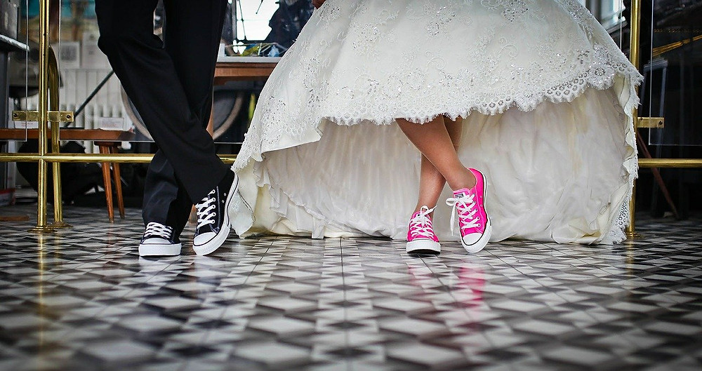 Bride and groom wearing funky trainers on their wedding day