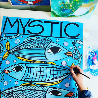 Atelier Vero Hand with paintbrush painting a Happy Colorful Painting Mystic with Cheerful Fish and Hand Lettering