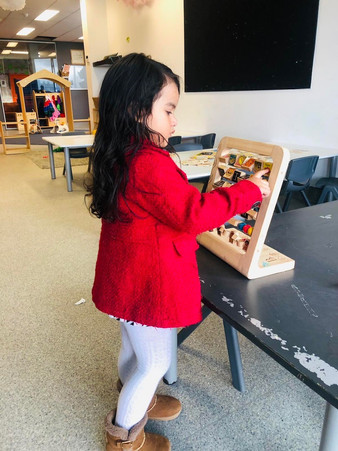 Young child learning with abacus - Eduplay Childcare Otahuhu