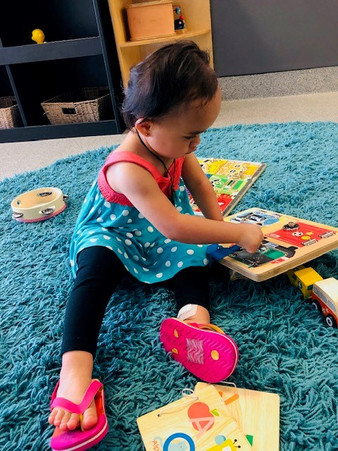 Toddler playing with puzzle at our Childcare Centre - Eduplay Otahuhu