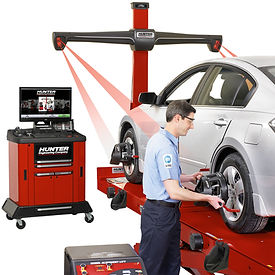 Mechanic performing wheel alignment services in Naples, FL