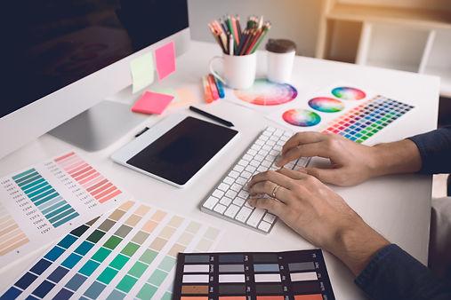 freelance-creative-designers-working-on-desk-in-mo-JVRR76M.jpg