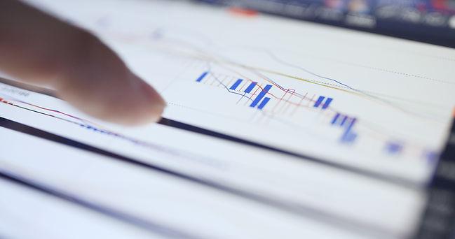 digital-tablet-showing-the-stock-market-data-TGVRUCQ.jpg