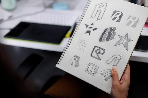 hand-holding-notebook-with-drew-brand-logo-creativ-PD54U75.jpg