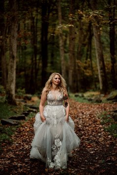 Bride walks through woods at Fernstone Retreat, PA