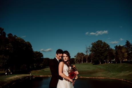 Tattooed bride and groom embrace