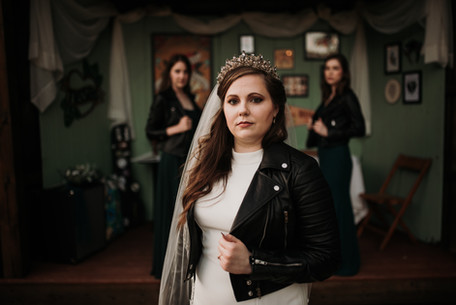 Bride wearing a leather jacket at Cole's Green Acres in Pennsylvania