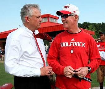 Lee Fowler and football coach Tom O'Brian talk at a Wolfpack Caravan.