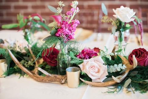blush-wine-antler-wedding-centerpiece