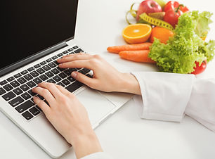female-nutritionist-working-on-laptop-PA