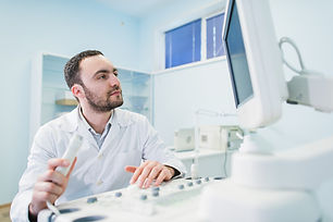 male-doctor-with-ultrasonic-equipment-du