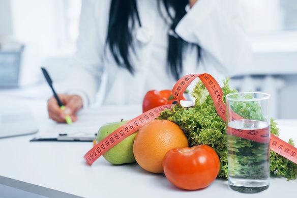 female-nutritionist-in-white-coat-sittin
