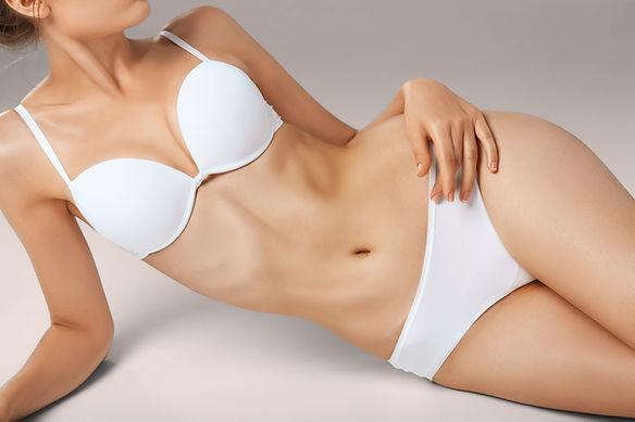 unrecognizable-slim-tanned-woman-body-in