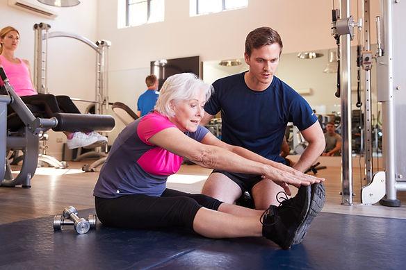 senior-woman-exercising-in-gym-being-enc