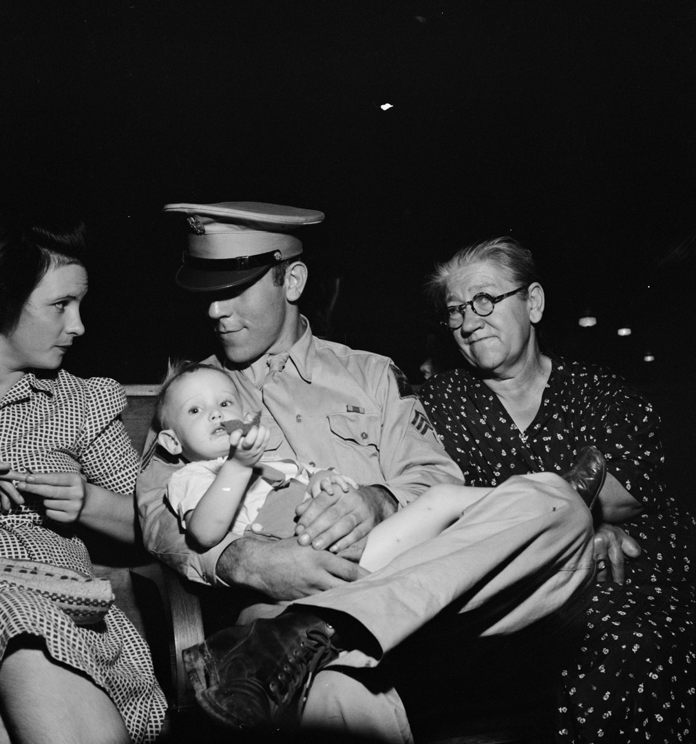 Lillian held by her father -- with her Aunt Sadie and Great Grandmother Esther. 1944.