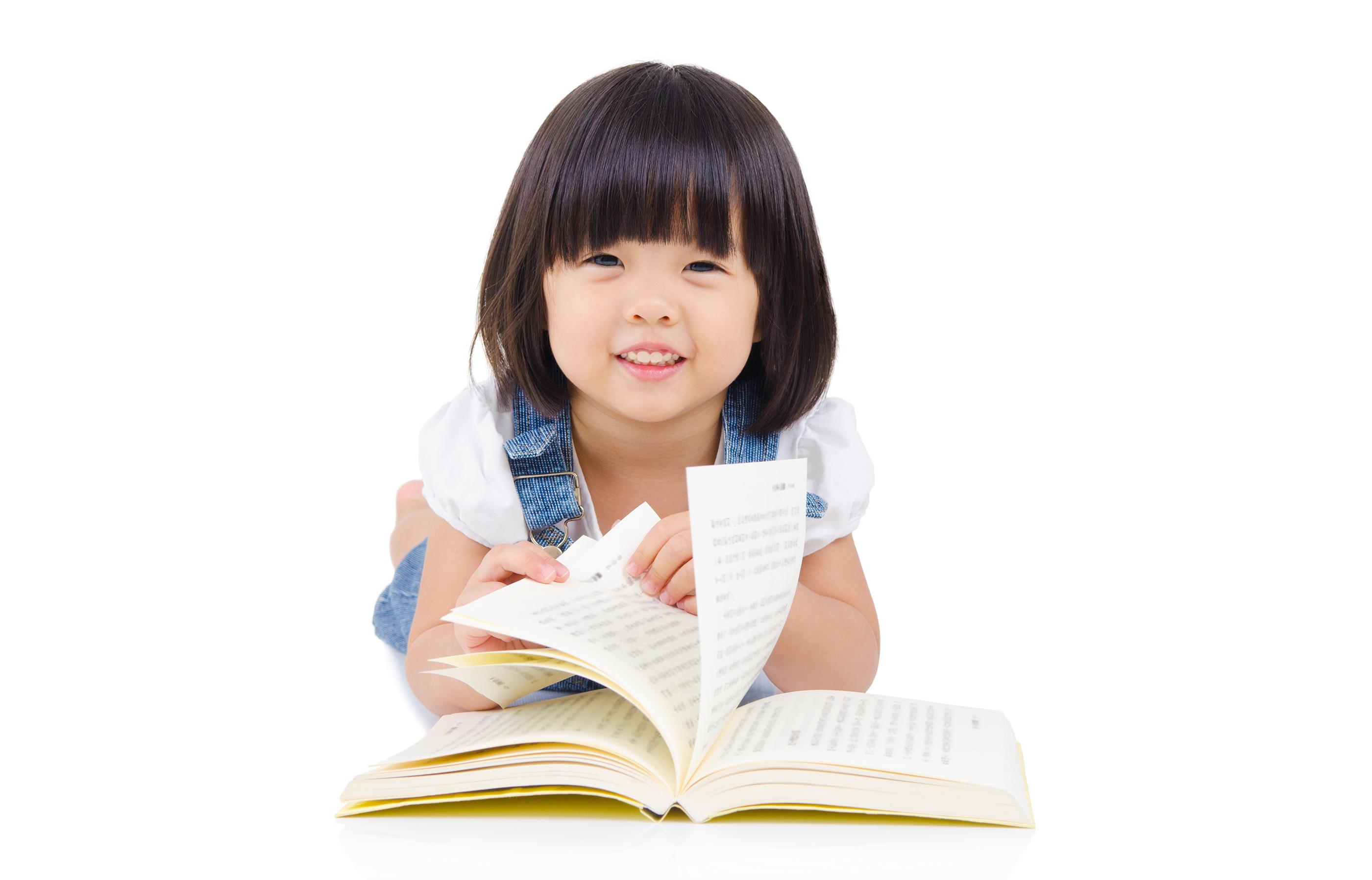 Cute asian girl reading