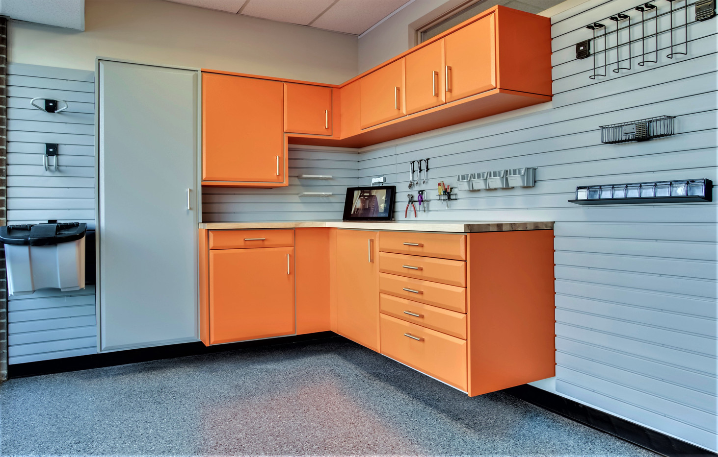 Powder coated cabinets with slat wall and epoxy floors from Designer Garages