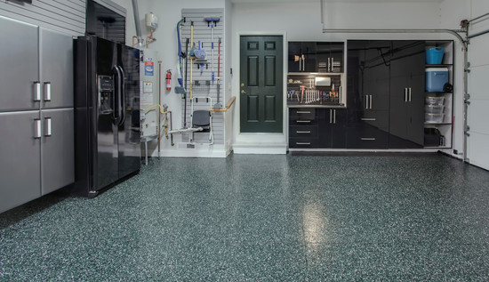 Epoxy floor and custom cabinets along with a slat wall to complete the garage from Designer Garages